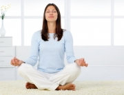 woman-meditating-in-living-room