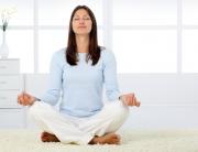 woman-meditating-in-living-room